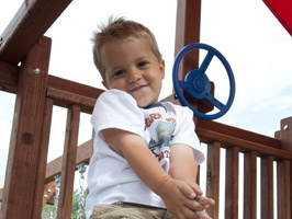 boy outside on play deck