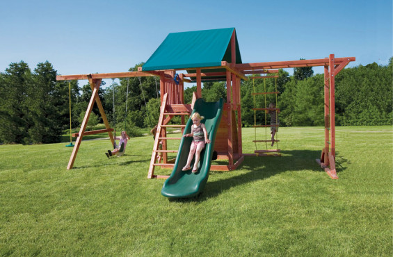 The Grandstand play set comes with a slide, 3 swings, a rock climbing wall, monkey bars, and more!