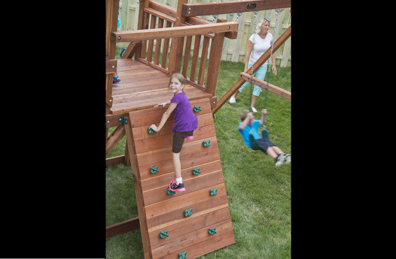 Our rock wall diversifies play & builds strength.