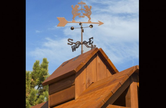 Redwood roof includes a beautiful cupola and whimsical weathervane.