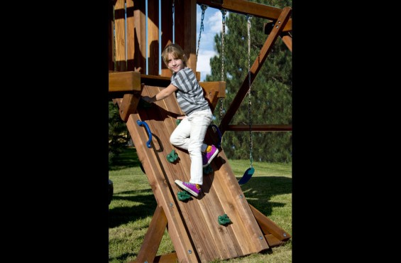 The climbing rock wall will present an adventurous way to reach the play deck. Includes green climbing rocks to help them along the journey.