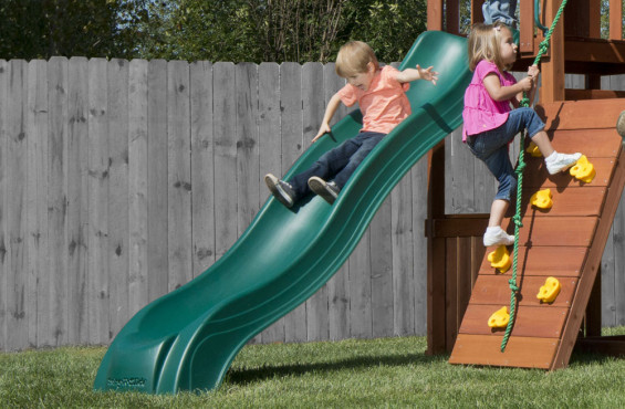The 9ft. wave slide offers an addicting way to the bottom time after time. Also pictured is the rock climbing wall which gives children the climbing experience they love.